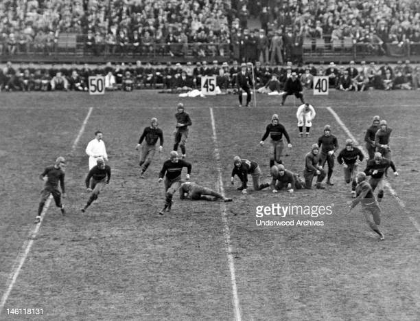 Notre Dame football player McGrath as he prepares to catch a forward pass from Walsh in a game against Army in Yankee Stadium, New York, New York,...