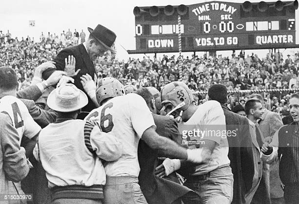 Notre Dame football players join students in giving Coach Terry Brennan a ride on their shoulders after the Irish scored the upset of the year...
