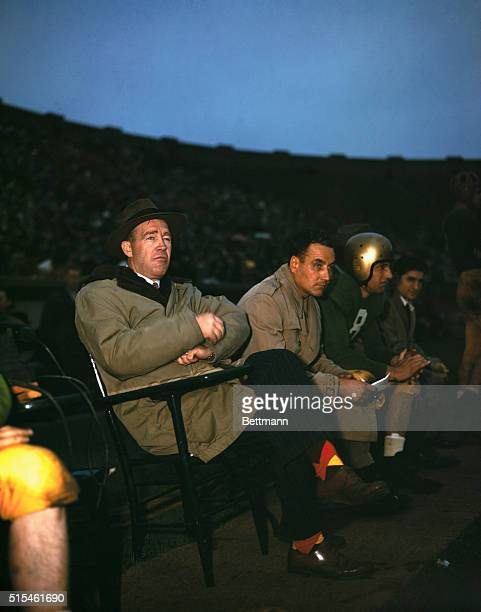 Notre Dame football team coach Frank Leahy is shown on the bench with players