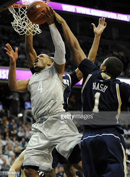 Notre Dame forward Tyrone Nash blocks a shot by Georgetown guard Chris Wright during secondhalf action at the Verizon Center in Washington DC...