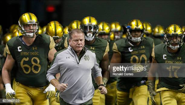 Notre Dame head coach Brian Kelly leads his team onto the field before the start of their game against Army in a NCAA college football game at the...