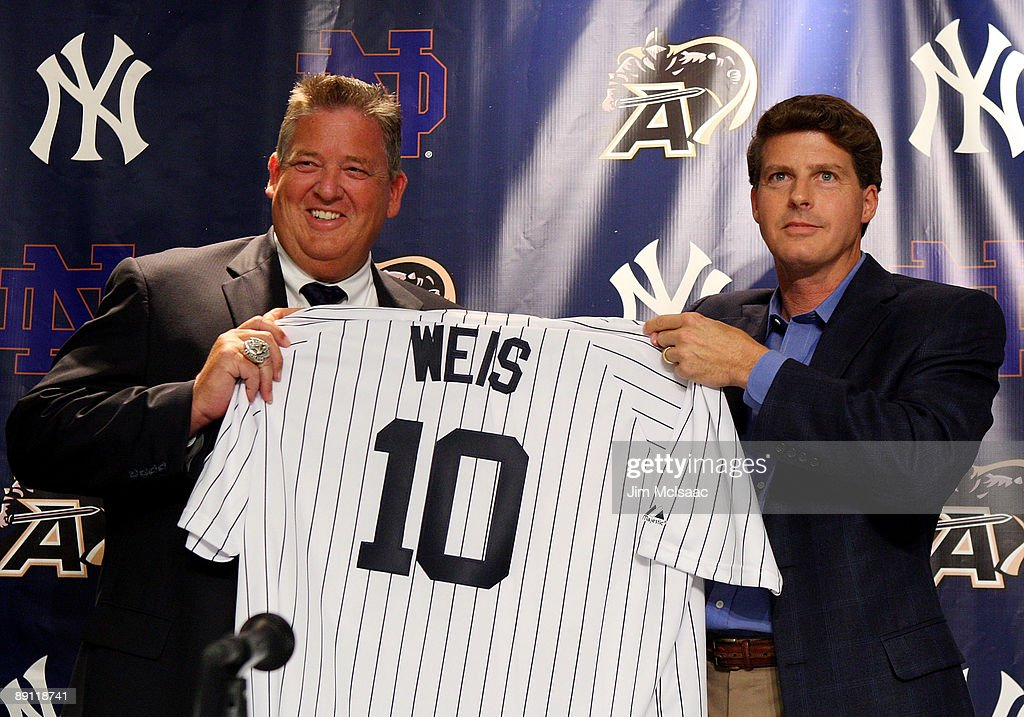 Notre Dame head coach Charlie Weiss and New York Yankees Managing General Partner Hal Steinbrenner pose for a photograph during a press conference announcing that Yankee Stadium will play host to the 2010 Notre Dame v Army college football game on July 20, 2009 at Yankee Stadium in the Bronx borough of New York City. The game is to be played on November 20, 2010.