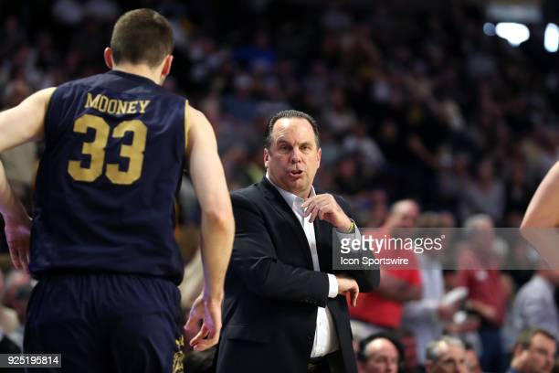 Notre Dame head coach Mike Brey talks to John Mooney during the Wake Forest Demon Deacons game versus the Notre Dame Fighting Irish on February 24 at...