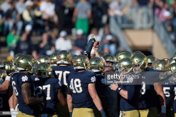 Notre Dame huddles up around Notre Dame Fighting Irish head coach Brian Kelly during the college football game between the Notre Dame Fighting Irish...