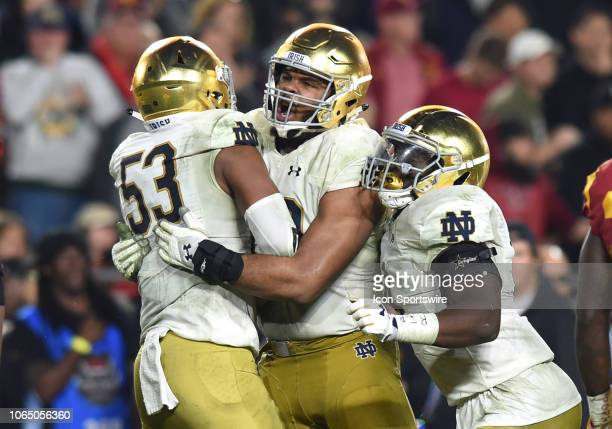 Notre Dame Jerry Tillery celebrates making a sack with Notre Dame Khalid Kareem and Notre Dame Te'von Coney during a college football game between...