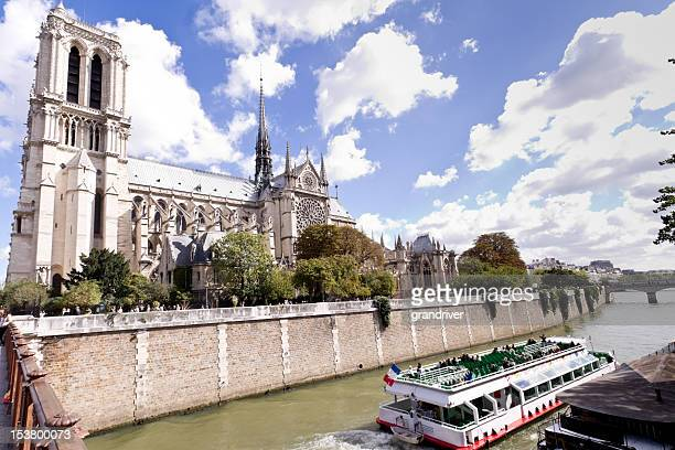 Notre Dame on Seine River with Tour Boat