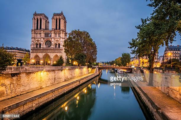 notre dame, paris and river seine - notre dame de paris stock photos and pictures