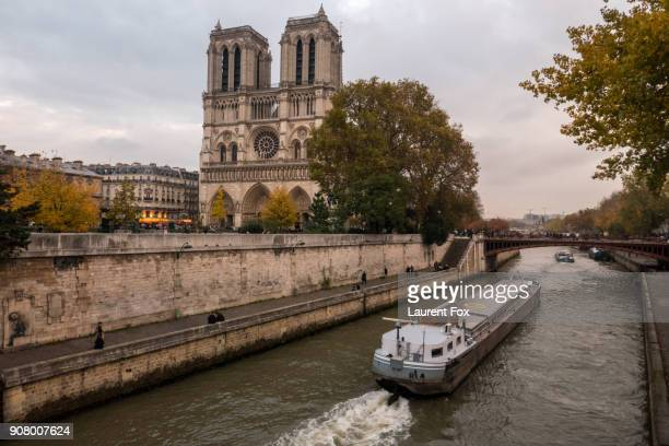 notre dame - barge stock photos and pictures
