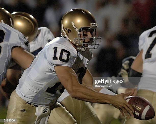 Notre Dame quarterback Brady Quinn prepares to hand off in Notre Dame's 49-28 win over Purdue in Ross Ade Stadium, West Lafayette, IN 10-1-05.