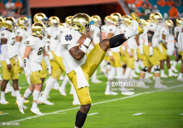 Notre Dame Quarterback Brandon Wimbush holds a football as he warms up during the college football game between the Notre Dame Fighting Irish and the...