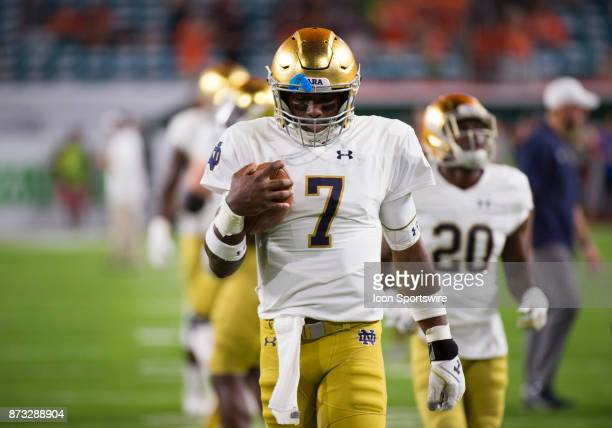 Notre Dame Quarterback Brandon Wimbush looks down on the field during the college football game between the Notre Dame Fighting Irish and the...