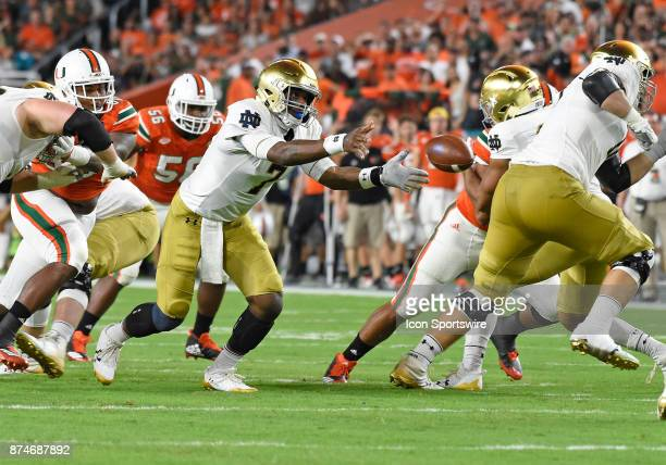 Notre Dame quarterback Brandon Wimbush pitches out during an NCAA football game between the Notre Dame Fighting Irish and the University of Miami...