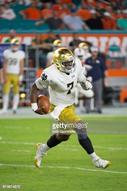 Notre Dame Quarterback Brandon Wimbush runs with the ball during the college football game between the Notre Dame Fighting Irish and the University...