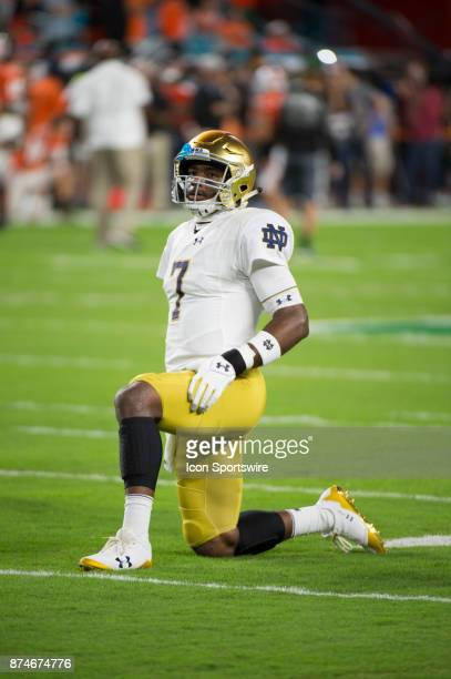 Notre Dame Quarterback Brandon Wimbush stretches on the field as he warms up during the college football game between the Notre Dame Fighting Irish...