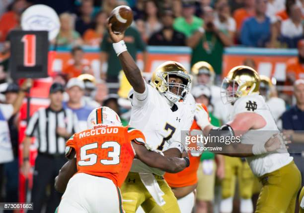 Notre Dame Quarterback Brandon Wimbush throws the ball under pressure from University of Miami Hurricanes Linebacker Zach McCloud during the college...