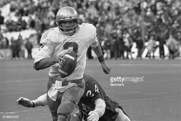 Notre Dame quarterback Joe Montana runs out of the arms of Houston's Fred Snell during the final drive of the game that led to Notre Dame's 35-34...