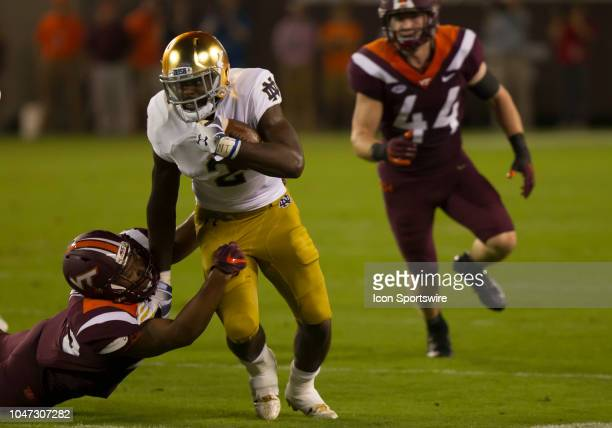 Notre Dame running back Dexter Williams rushes upfield during a game between the Virginia Tech Hokies and the Notre Dame Fighting Irish on October 06...