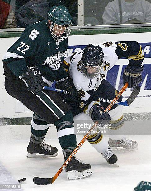 Notre Dame senior center Aaron Gill maneuvers around Lee Falardeau of Michigan State The two teams tied 33 after OT