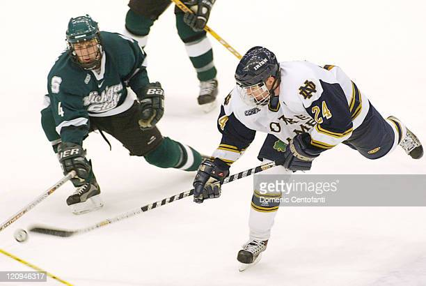 Notre Dame senior defensement Tom Galvin races for the loose puck Saturday evening while freshman left defense for the Spartans Ethan Graham l The...