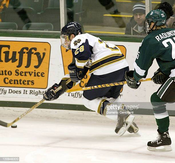 Notre Dame sophomore left wing Tim Wallace gets chased by Michigan State junior left wing Brock Radunske The two teams tied 33 after OT