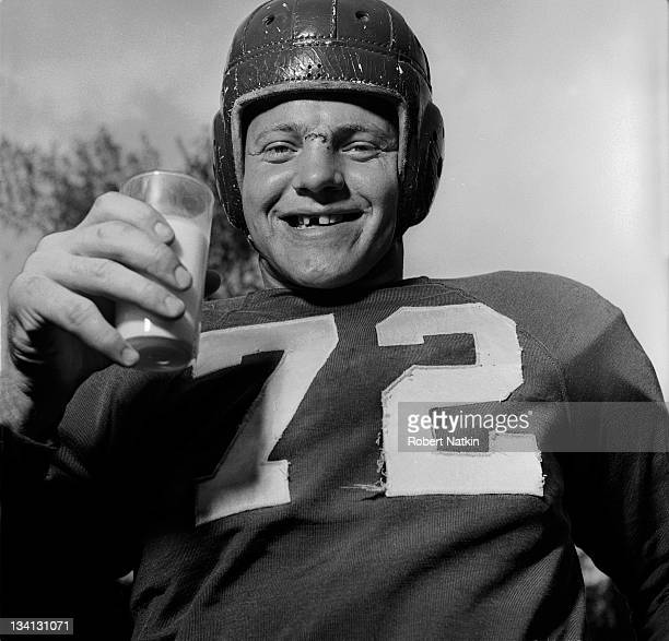 Notre Dame standout and Chicago Cardinals football player Bill Fischer complete with wellworn helmet frayed jersey bloody forehead and a missing...