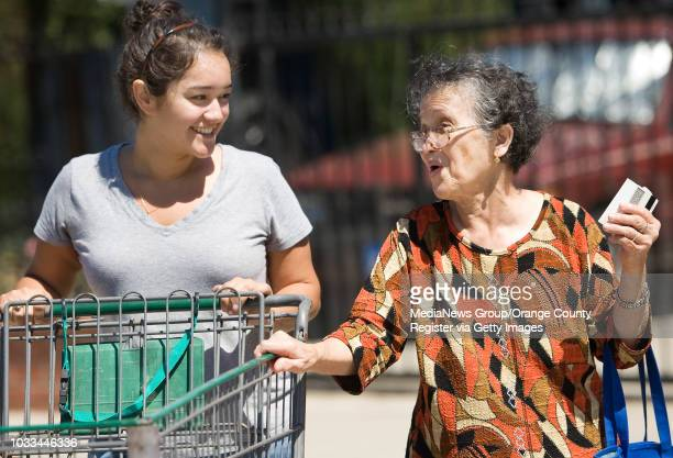 Notre Dame student Karina Linden who works at the Southwest Community Center in Santa Ana through the Summer Service Learning Program helps senior...