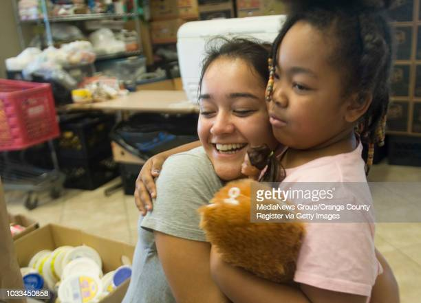 Notre Dame student Karina Linden works at the Southwest Community Center in Santa Ana through the Summer Service Learning Program She hugs founder...
