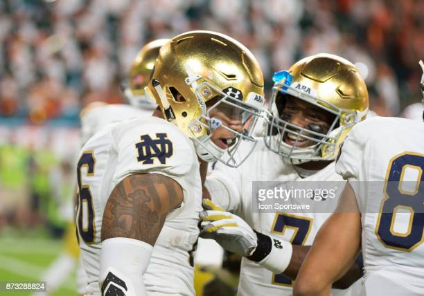 Notre Dame Tight End Alize Mack celebrates scoring a touchdown with Notre Dame Quarterback Brandon Wimbush during the college football game between...