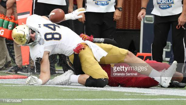Notre Dame tight end Cole Kmet falls out of bounds after a catch during the Camping World Bowl against Iowa State at Camping World Stadium in Orlando...