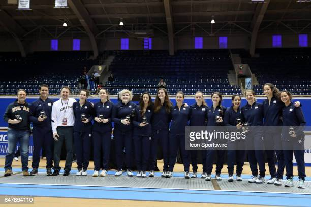 Notre Dame's coaches and players pose with their individual awards after winning the Women's Team championship From left assistant coaches Buckie...