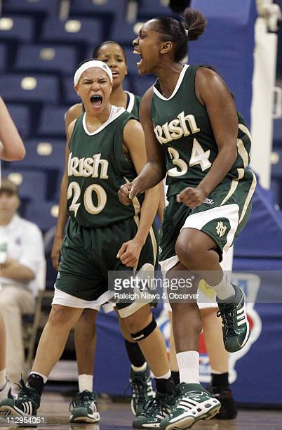 Notre Dame's Crystal Erwin and Ashley Barlow celebrate after Erwin was fouled while making a basket during a game against California in the first...