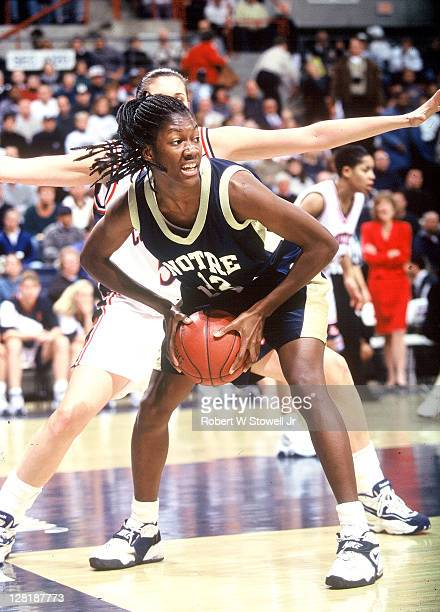 Notre Dame's Katryna Gaither goes to work against the University of Connecticut's defense Storrs CT 1996