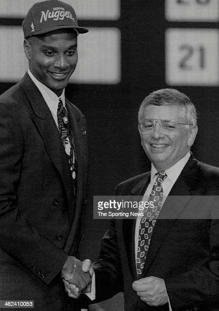 Notre Dame's LaPhonso Ellis is greeted by NBA Commissioner David Stern right after Ellis was picked fifth overall in the first round NBA Draft by the...