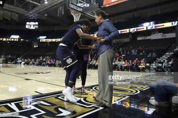 Notre Dame's Lili Thompson is helped off of the court after suffering a gameending injury during the Wake Forest Demon Deacons game versus the Notre...
