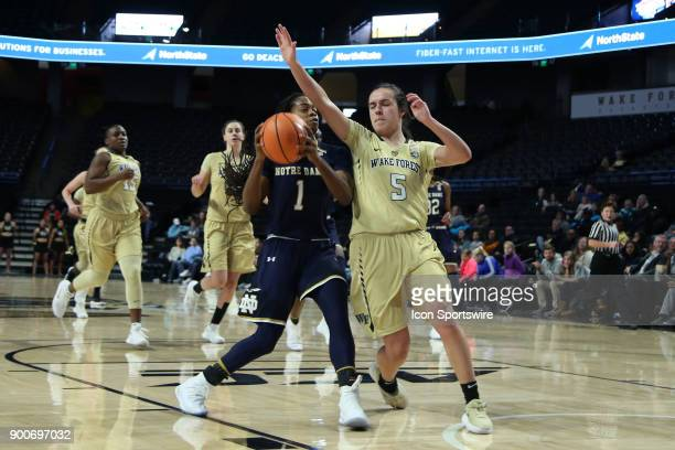 Notre Dame's Lili Thompson suffered a gameending injury while being guarded by Wake Forest's Gina Conti during the Wake Forest Demon Deacons game...