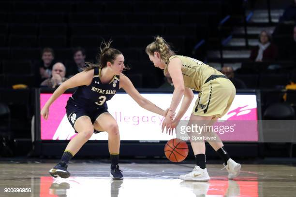 Notre Dame's Marina Mabrey fouls Wake Forest's Alex Sharp during the Wake Forest Demon Deacons game versus the Notre Dame Fighting Irish on December...