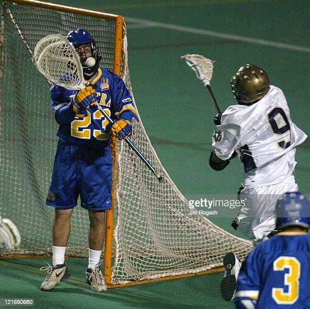 Notre Dame's Matt Ryan right fires on Hofstra' goalie Matthew Southard at Harvard University's Jordan Field during The Algonquin Cup College Lacrosse...