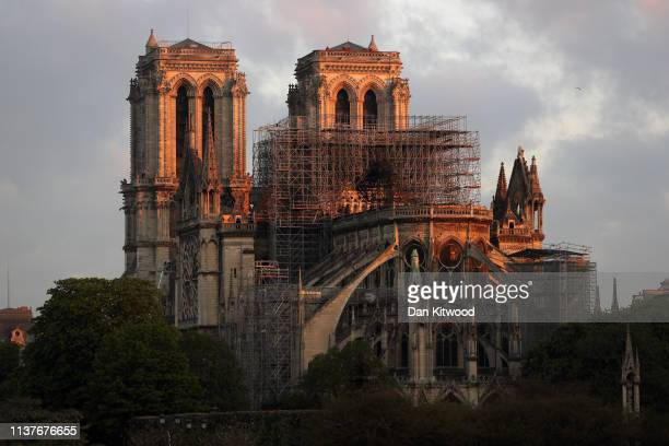 NotreDame Cathedral is seen at sunrise following a major fire on Monday on April 17 2019 in Paris France A fire broke out on Monday afternoon and...