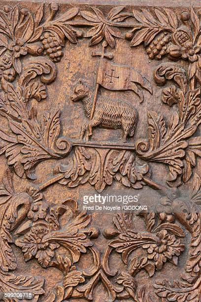 Notre-Dame de la Visitation church. Carved church door. The lamb holding a Christian banner is a typical symbol for Agnus Dei.