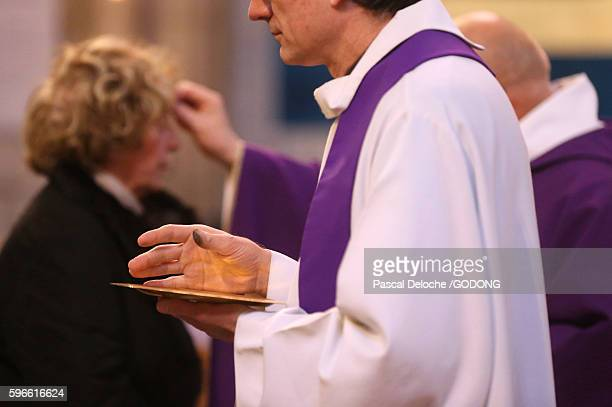 notre-dame du perpetuel secours basilica. ash wednesday. - ash wednesday stock pictures, royalty-free photos & images