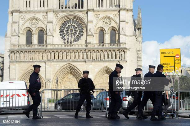 NotreDame neighbourhood is surrounded by police after a man struck a police officer with a hammer on June 6 2017 in Paris France