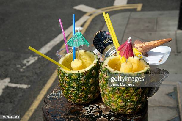 Notting Hill Carnival 2016 Children's Day Two discarded pineapples which had been filled with rum punch alongside an empty beer can and icecream