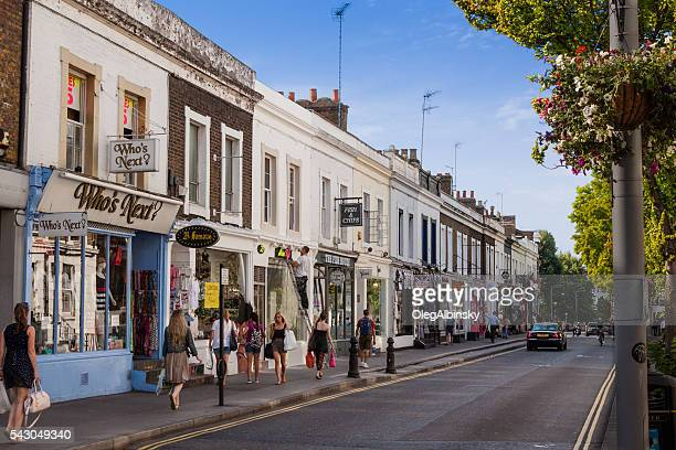 Notting Hill Street lined with Stores, London, England.
