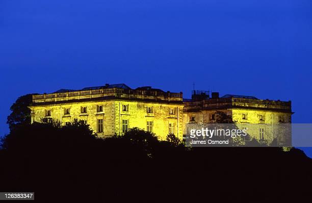 Nottingham Castle Museum illuminated at night.