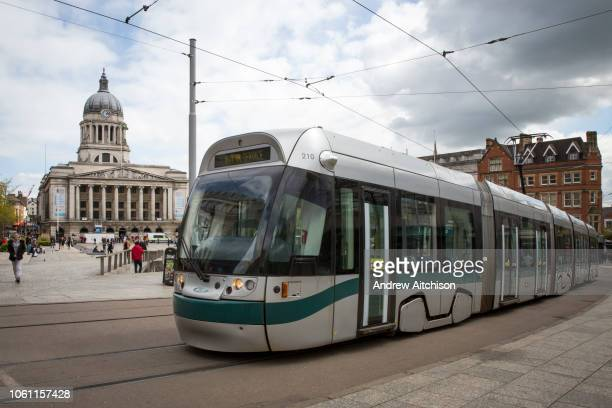 Nottingham Express Transit tram, number 210, travelling through Nottingham city centre outside Old Market Square, Nottingham, Nottinghamshire, United...