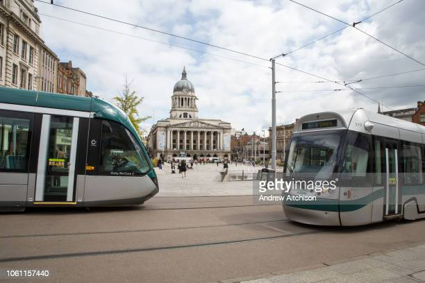 Nottingham Express Transit trams, travelling through Nottingham city centre outside Old Market Square, Nottingham, Nottinghamshire, United Kingdom....