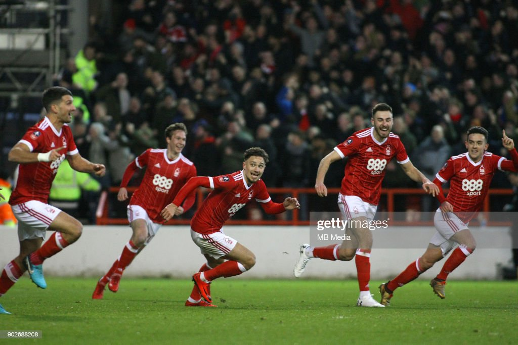 Nottingham Forest celebrate going ahead through Eric Lichaj's header during The Emirates FA Cup Third Round match between Nottingham Forest and Arsenal at City Ground on January 7, 2018 in Nottingham, England..