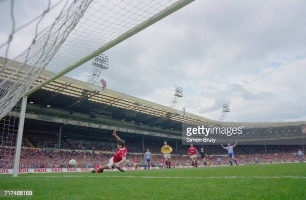 Nottingham Forest defender Brian Laws clears the ball away from goal after a Brian McLair of Manchester United effort during their Rumbelows Football...