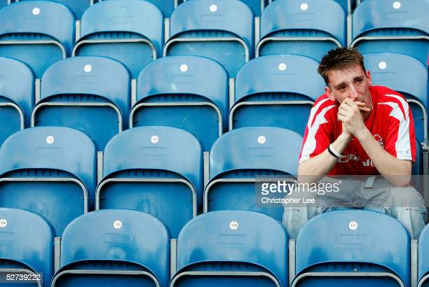 Nottingham Forest fan looks dejected after his side lose during the Coca-Cola Championship match between Queens Park Rangers and Nottingham Forest at...