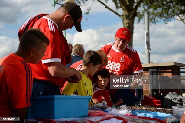 Nottingham Forest fans look at a merchandise stall before the Sky Bet Championship match between Nottingham Forest and Leeds United at City Ground on...